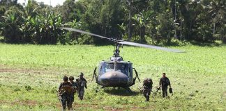 Army soldiers disembark from a Huey chopper Monday (28 November 2016) as they join the fight against the Maute group in Butig, Lanao del Sur. The group linked to ISIS has once again occupied the town center. MindaNews photo by Ferdinandh Cabrera