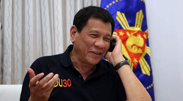 President Rodrigo Roa Duterte congratulates United States of America President-elect Donald Trump through a phone call at Legaspi Suites in Davao City on December 3, 2016. RICHARD MADELO/Presidential Photo