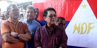 Local Government Secretary Mike Sueno and Labor Secretary Silvestre Bello III attend the 48th founding anniversary celebration of the Communist Party of the Philippines in the hinterland village of Lumiad in Paquibato District, Davao City on Monday, December 26. Mindanews Photo