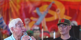 National Democratic Front of the Philippines senior adviser Luis Jalandoni speaks in a press conference during the 48th founding anniversary celebration of the Communist Party of the Philippines in the hinterland village of Lumiad in Paquibato District in Davao City on Monday, December 26. Beside Jalandoni is NDF consultant Porferio Tuna. Mindanews Photo