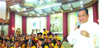 Fr. Lamata with St. Jude rondalla group_photo courtesy of Davao catholic Herald