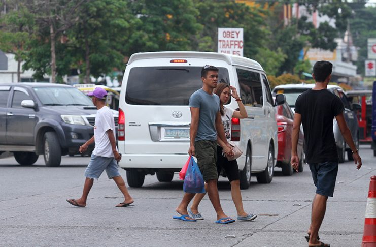 NOT IN THE LIST. Pedestrians can cross the street wherever they want along Lapu-lapu Street in front of Agdao Public Market as there are no pedestrian lanes in the area or traffic enforcers that supposedly will apprehend violators of the recently implemented Anti-Jaywalking Ordinance. LEAN DAVAL JR.