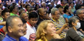 IN UNISON. Barangay officials laugh their hearts out while listening to President Duterte's funny statements during their Christmas party at the Davao City Recreation Center on Tuesday night. LEAN DAVAL JR.