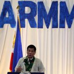 DUTERTE BEFORE ARMM LGUS. President Rodrigo R. Duterte speaks before government officials of the 3rd Autonomous Region in Muslim Mindanao (ARMM) Local Government Summit held at SM Lanang Premier's SMX Convention Center on Thursday night. LEAN DAVAL JR.