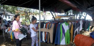 "VARIETY. A teenager chooses from a wide collection of ready-to-wear clothes on display at the ""ukay-ukay"" section of Magsaysay Park in Davao City yesterday. LEAN DAVAL JR."