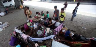 SENT HOME. Most lumads being hosted by the city government of Davao were sent home yesterday while others, like this group living temporarily under Agdao flyover, will continue to ask Christmas gifts from the city's residents until Christmas day. LEAN DAVAL JR.