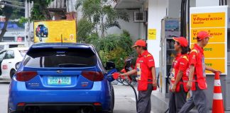 LOADING UP. A pump attendant fills up a vehicle at a gasoline station along Quirino Avenue in Davao City yesterday. Petroleum companies implemented another round of price increases in gasoline, kerosene and diesel yesterday, five days before Christmas. LEAN DAVAL JR.