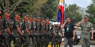 RETURNING THE FAVOR. President Rodrigo Duterte salutes to the soldiers upon his arrival at the North Luzon Command Headquarters in Camp General Servillano Aquino in San Miguel, Tarlac City on Sunday afternoon. ACE MORANDANTE/Presidential Photo