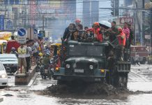 A military truck ferries commuters and workers in Cagayan de Oro City on January, 17, 2017. Several people were stranded overnight because the highways and roads were made impassable by flash floods that hit the city on Monday, January 16. MindaNews photo by Froilan Gallardo