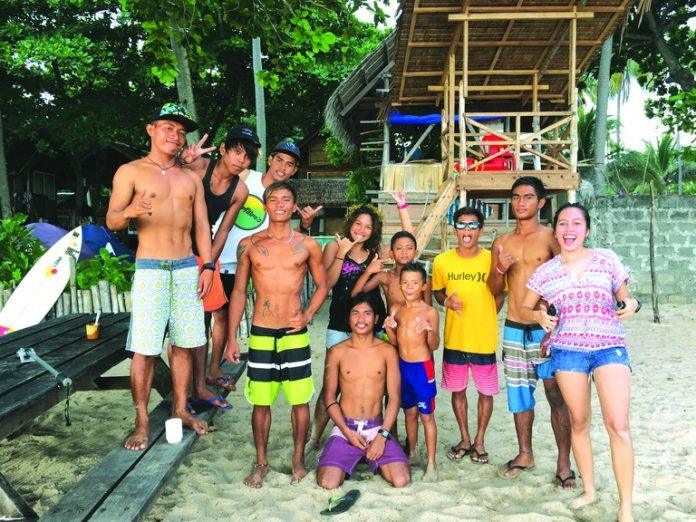 Sometimes, what makes a great adventure is making friendships that will last lifetimes. With me in this photo are Dahican Boardriders - locals from Dahican in Mati, Davao Oriental. They frequently hang around Dahican Surf Resort and because of my frequent visits, most of them became actual friends and surf mentors. Photo by Johnlery Padero