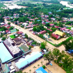 HARD-HIT. A bird's eye view of the poblacion of Kapalong, Davao del Norte, one of the most affected provinces in Mindanao, shows the extent of the flooding brought by days of heavy downpour which displaced thousands of residents in this municipality and in other provinces. Photo courtesy of Billy Dandryll Dulatre/PIO DAVNOR