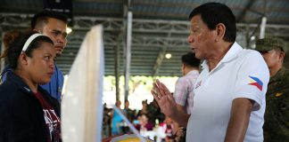 President Rodrigo Duterte condoles with Glaiza Yadao, wife of the late Corporal Michael D Yadao, who was killed in an encounter with the New People's Army at Brgy. Lamanan in Calinan District, Davao City on February 16, 2017 The President visited the wake of Yadao at the Naval Station Felix Apolinario, Panacan, Davao City on February 17, 2017. TOTO LOZANO/Presidential Photo