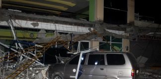 QUAKE DAMAGE. A car parked near the main entrance of Surigao State College and Technology along Narciso St. in Surigao City got damaged after debris from the building fell as a result of the 6.7 magnitude earthquake late Friday evening (10 Feb 2017). Dozens of people were hospitalized at the Caraga Regional Hospital. MindaNews photo by Roel N. Catoto