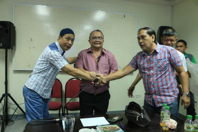 APPROVAL. Board Member Anacleto Macatabog, head of the Provincial Public Muslim Cemetery Task Force, shakes hand with Datu Nestor Vicente of the UNADIM at the presence of PGO Chief of Staff Ednar Dayanghirang (center). The provincial government of Davao Oriental and the UNADIM recently approved the opening of the 1st Muslim cemetery in the province. (Eden Jhan Licayan/PIO DavOr)