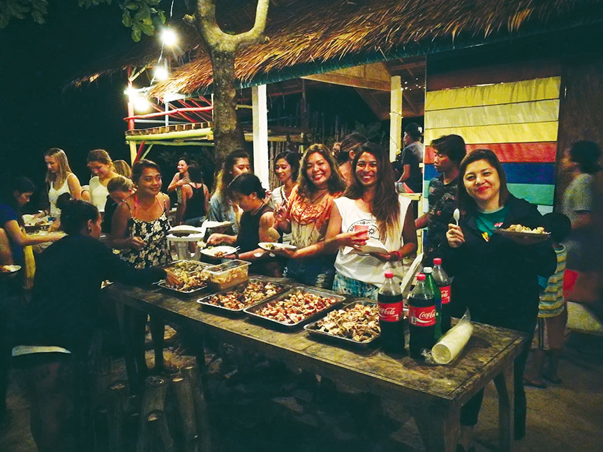 DSR guests, Dahican locals and surfing community get together for dinner prepared by Surf Shack's Jek-Jek Ilagan