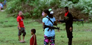 REBEL MADONNA. A woman member of the rebel New People's Army attends a gathering of the communist rebel group with her young son in the hinterlands of Davao City. President Duterte on Friday ended the government's six-month unilateral ceasefire with the NPA and ordered the Armed Forces of the Philippines to be ready to fight. LEAN DAVAL JR.