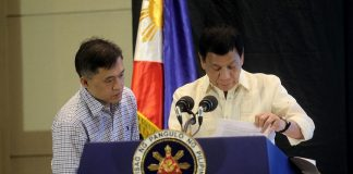 """PROOF OF THE PUDDING. President Rodrigo Duterte browses through a copy of a study that says there was an increase in heinous crime cases and increase in the number of detainees in the country's penal institutions after the lifting of the death penalty. Duterte, together with Presidential Management Staff head Christopher """"Bong"""" Go, shared the result of the study to the crowd during The Manila Times 5th Business Forum at The Marco Polo Davao on Friday afternoon. LEAN DAVAL JR."""