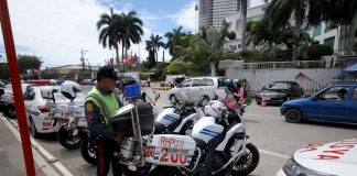 ROUTINE. A police officer from the Highway Patrol Group inspects his motorcycle upon his group's arrival from escorting ASEAN dignitaries in front of The Marco Polo Davao where the ASEAN Labor Ministers' Retreat is being held yesterday. LEAN DAVAL JR.