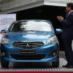 President Rodrigo Roa Duterte touches the hood of the first Philippine-made Mitsubishi Mirage G4 during the launching at Malacañan Palace on February 24, 2017. Also in the photo is (second from right) Mitsubishi Motors Corporation-Japan President and CEO Osamu Masuko. The Mitsubishi Mirage G4s, which are part of the Comprehensive Automotive Resurgence Strategy (CARS) program, were manufactured at the company's plant in Sta. Rosa, Laguna. RICHARD MADELO/Presidential Photo