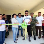 BIRTHING CENTER. Dr. Arvin Alejandro (3rd from right), provincial health officer of Sarangani province, together with Robinson Tao (center), barangay captain of Baliton, Glan and Dr. Gliceria Corsame (2nd from left), municipal health officer of Glan cut the ceremonial ribbon to officially open a birthing home worth P1.7 million funded by the Department of Health (DOH) and the provincial government. The ceremony was held during the Buntis Day and Dedication of Baliton Birthing Home last March 17 witnessed by Sharon Rose Dacera (extreme right) of Kiwanis International, Col. Alano Abdulhalim (2nd from right), commander of Eastern Mindanao Naval Reserve Force, and Razel Bustria (extreme left) of provincial health office. (Jake Narte/SARANGANI INFORMATION OFFICE)