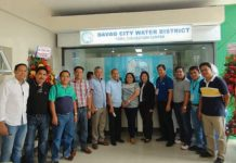 DCWD office opens anew in Toril District Hall. DCWD management headed by assistant general manager for administration Alfonso E. Laid (6th from L) poses for posterity during the inauguration and blessing of the new office.