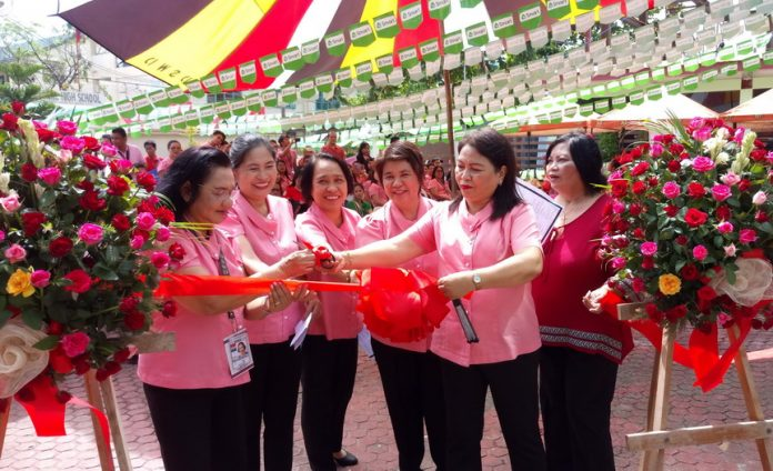 DSWD @66. Members of Management Committee of the Department of Social Welfare and Development (DSWD) Region XI led by Director Mercedita P. Jabagat [second from right] cut the ceremonial ribbon on Monday to mark the opening of the week-long celebration of the DSWD 66th Founding Anniversary. Theme for the observance is Sama-samang Paglilingkod ng may Malasakit. Other ManCom members are [from left] ARD for Administration Ma. Vilia L. Vigil, Chief Admin. Officer Teresita V. Mercado, Institutional Development Chief Ma. Elena S. Labrador, Policy and Plans Chief Estrella D. Brigole and ARD for Operations Rebecca A. Santamaria. (DSWD Photo)