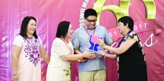 "Governor Anthony del Rosario with DavNor PSWD Officer Ms. Arlene Semblante accept the ""Fully Functional LSWDO"" award from RXI DSWD Director and DSWD Secretary Judy Taguiwalo during the department's 66th anniversary at Grand Men Seng Hotel on March 3, 2017. The Tagum CSWDO, Kapalong MSWDO, Braulio E. Dujali Volunteer and Talaingod KALAHI-CIDSS Federation Association were also honoured during the event."