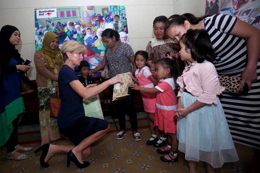 GIFT FOR THE CHILDREN. Australian Foreign Affairs Minister Julie Bishop hands over a gift to a student from the Autonomous Region of Muslim Mindanao (ARMM) on Friday at the Marco Polo Hotel in Davao City during the launching of the A$90-M Education Pathways Program for Mindanao that will funded by the Australian government. LEAN DAVAL JR.