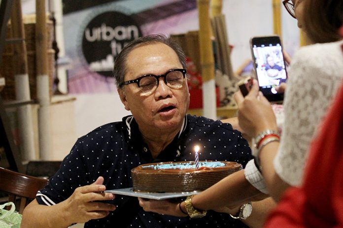 ON THE SPOTLIGHT. Edge Davao editor-in-chief Antonio M. Ajero blows out his candle for his 71st birthday after he was surprised and greeted by friends and colleagues during Wednesdays @Habi at Kape at Abreeza Mall on Wednesday. LEAN DAVAL JR.