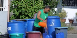 PRESSING NEED.A resident refills a container with water he bought from a company rationing potable water in Deca Homes, Cabantian, Davao City on Tuesday morning. Residents of subdivisions in the area are calling the attention of the authorities as they are experiencing water shortage since January of this year. LEAN DAVAL JR.