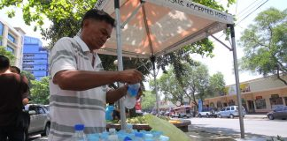 RECYCLABLE. A scavenger gathers recyclable used bottled water container he collected from restaurants around the downtown area of Davao City yesterday. Experts said there will be more plastic than fish in the sea by 2050 as 40% of these end up in landfill, a third in fragile ecosystems such as the world's oceans and just 5% are recycled effectively. LEAN DAVAL JR.