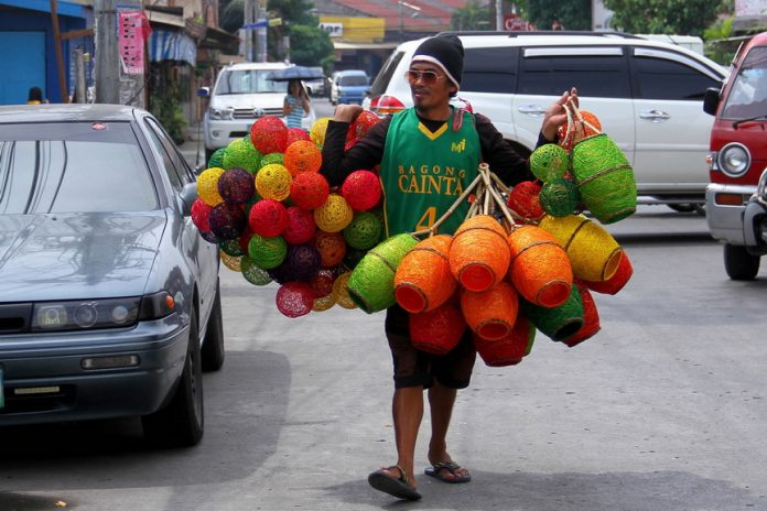 HAND-MADE BY LOCALS.A hawker peddles colorful hand-crafted lamps near a hotel in Bo. Obrero, Davao City yesterday. Dealers of native items in Davao City take advantage of the 80th Araw ng Davao celebration to showcase their products when large number of domestic and foreign tourists arrives in the city. LEAN DAVAL JR.
