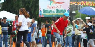 NO-HOLDS BARRED. Employees of the city government of Davao compete in a traditional game known as 'karang' during the Employees Day, which is among the activities of the 80th Araw ng Davao, at Rizal Park yesterday. LEAN DAVAL JR.