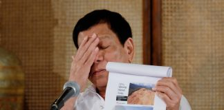 DARK SIDE. President Rodrigo Duterte expresses disappointment while showing photos of forests and bodies of water that have been destroyed by illegal mining companies during a press conference at the Rizal Hall at Malacañan Palace on Monday evening. RENE LUMAWAG/Presidential Photo