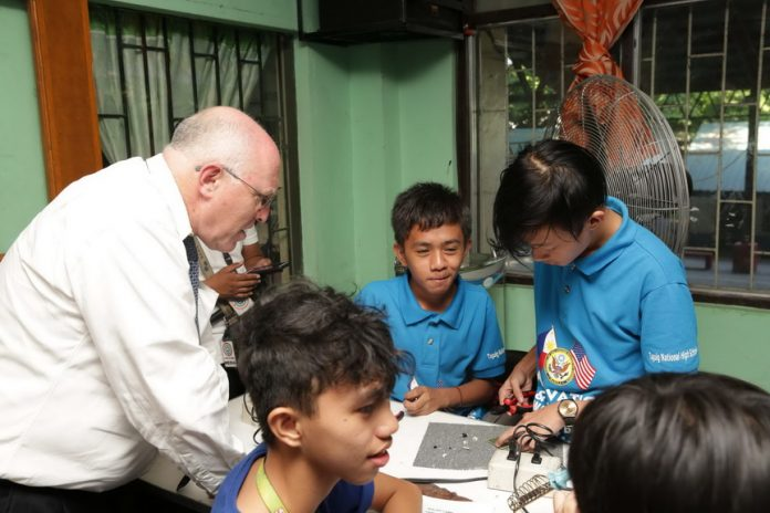 CDA Klecheski assembles solar-powered lamps with Access Program students at the Lights for All Project launch in Taguig.