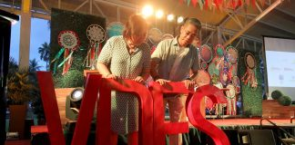 FINAL GO-OVER. Davao City's leading tourism movers City Tourism Office head GeneRose Tecson (left) and Visit Davao Fun Sale (VDFS) Execom chair Benjie Lizada make a last minute checking on the details of the VDFS signage before the start of the grand opening of Davao Region's biggest summer tourism event, the VDFS 2017, dubbed #rockyourSPArty held at the Waterfront Insular Hotel in Davao City on Wednesday evening. LEAN DAVAL JR.