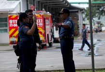 ASSESSING THE DAMAGE. Police Regional Office (PRO0 11 director Chief Superintendent Manuel Gaerlan (right) conducts site inspection at Lapanday Box Plant in Mandug, Davao City on Saturday with Buhangin Police Precinct commander Chief Inspector Milgrace Driz (left) after it was attacked and burned by the New People's Army (NPA LEAN DAVAL JR.