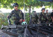 WEAPONRY. A member of Task Force Davao explains the specifics of the different weapons on display during the organization's 14th founding anniversary at the TF Davao headquarters in Davao City on Wednesday. LEAN DAVAL JR.