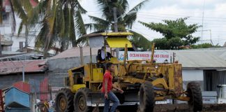 LONG TIME COMING. A man passes by a grader machine which is being used for the rehabilitation of Sta. Ana Port in Davao City on Tuesday. The city government of Davao is positioning the port to be one of the city's tourist destinations in the coming months. LEAN DAVAL JR.