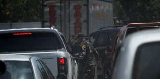 ROUTINE. A member of Task Force Davao inspects a private vehicle upon entering Davao City at a checkpoint in Sirawan, Toril on Tuesday. LEAN DAVAL JR.