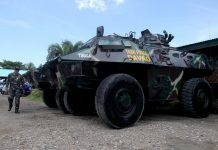 ADDED EDGE. A Task Force Davao officer walks by light armor vehicles known as Simba which are on display during the organization's 14th founding anniversary at the TF Davao headquarters in Davao City on Wednesday. LEAN DAVAL JR.