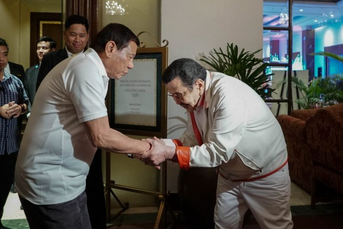 HONORED GUEST. President Rodrigo Duterte is warmly received by former President and incumbent Manila City Mayor Joseph Estrada upon his arrival at Manila Hotel on Wednesday night for Estrada's 80th birthday celebration. KING RODRIGUEZ/PRESIDENTIAL PHOTO