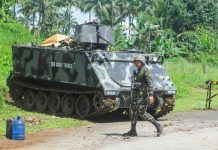 An armored personnel carrier of the Philippine Army is parked along the Iligan-Marawi Highway in the municipality of Pantar, Lanao del Norte on Wednesday (24 May 2017) as soldiers help contain the Maute Group attack in Marawi City. MindaNews photo by Froilan Gallardo