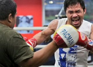 NO LET UP. Manny Pacquiao hits the mitts with trainer Buboy Fernandez.
