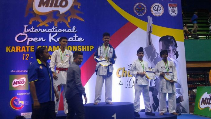 GOLD. John Philip Cagadahan of AAK Davao receives his gold medal during the awarding ceremonies of the recent 18th Milo Malaysia Open Karatedo Tournament in Kuala Lumpur, Malaysia.
