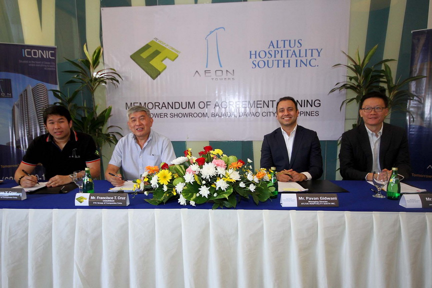MOA SIGNING. FTC Group of Companies president Ian Y. Cruz and Chairman Francisco T. Cruz sign the landmark deal with Altus Hospitality South Inc. officials.
