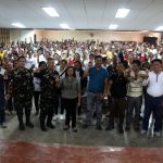 Top army executives in the province and City Government officials together with the participants of the Peace Building Seminar make the peace sign during the seminar's closing ceremony.
