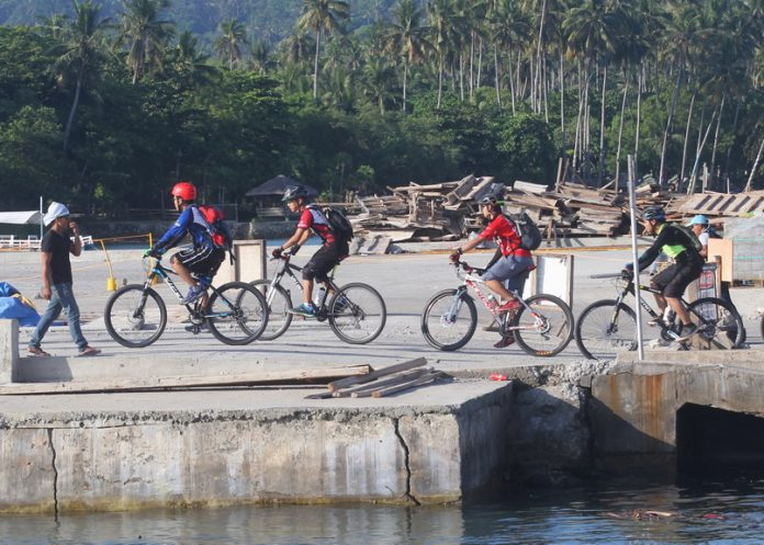 FULFILLED.Mountain bicycle riders from Davao City disembark from a ferry boat at Babak Port in thr Island Garden City of Samal on Thursday. Bicycle enthusiasts frequent the island due to its challenging terrain and scenic view. LEAN DAVAL JR