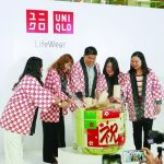 Katsumi Kubota, Chief Operating Officer, Uniqlo Philippines (center) opens the ceremonial sake barrel together with (from left) Uniqlo Area Manager Binnah Kim, Japanese Consul to Davao, Tomoko Dodo, Uniqlo Store Manager Rose Velardo and SM Lanang Premier Operations Manager Therese Manalo ((right)