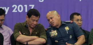 TRUSTED CONFIDANT.President Rodrigo Duterte listens as Philippine National Police chief Director General Ronald Dela Rosa confides very important matters meant only for the President' ears during AFAD Defense and Sporting Arms Show Davao at SMX Convention Center in Lanang, Davao City on Friday night. Duterte said he will implement a stricter regulation in the ownership and purchasing of firearms of the civilians in the country. LEAN DAVAL JR.